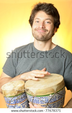 Guy playing the bongos