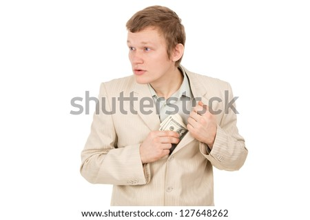 guy puts the money in his pocket and looks around isolated on white background