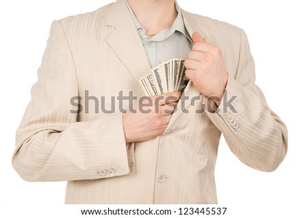 guy puts the money in his pocket isolated on white background