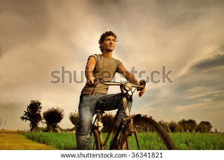 guy riding bicycle in the nature
