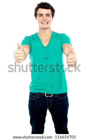 Guy showing thumbs up, arms stretched out. Isolated over white