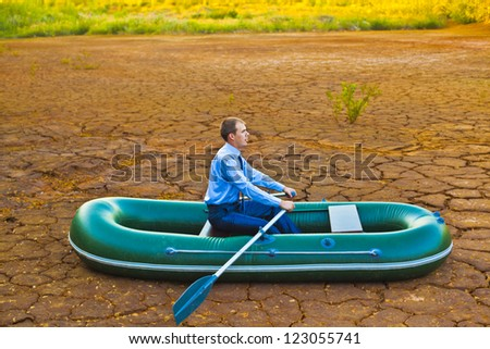 Guy will rows home for shore in paddle powered row boat businessman in boat rocks looks bright future symbol crisis stagnation losses braking difficulties environmental disaster water scarcity drought