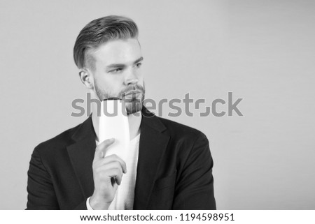 Guy with bristle holds bottle shampoo, copy space. Man enjoy freshness after washing hair with shampoo. Hair care and beauty supplies concept. Man thoughtful face hold shampoo bottle, grey background. #1194598951