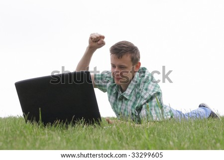 Guy with laptop - stock photo