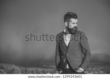 Guy with strict face enjoys scenery and view. Hipster with stylish appearance in front of dramatic sky, skyline. Man with beard and mustache on top of mountain, scenery on background. On top concept. #1299243601