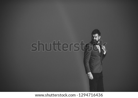 Guy with strict face in suit feels free and successful. Hipster with stylish appearance in front of sky with rainbow. Success and freedom concept. Successful stylish man with scenery on background. #1294716436