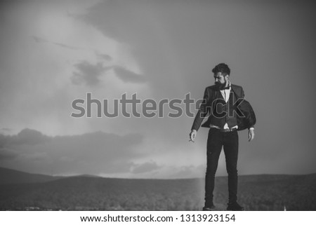 Guy with strict face in suit feels free and successful. Successful man with scenery on background. Hipster with stylish appearance smoking in front of sky with rainbow. Success and freedom concept. #1313923154
