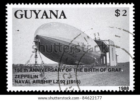 GUYANA - CIRCA 1988: A post stamp printed in Guyana shows 150th anniversary of the birth of zeppelin, The Graf Zeppelin, Naval Airship LZ 92 (1916), circa 1988