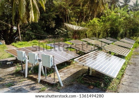 Guyed Cell Tower with solar panels installed on the ground. satellite dish, satellite antenna, satellite aerial, satellite receiver #1361494280