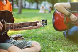 Guys Play Guitars in City Park Outdoor