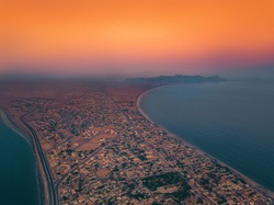 Gwadar City, Pakistan, Aeria View  Gwadar is a port city on the southwestern coast of Balochistan, Pakistan. The city is located on the shores of the Arabian Sea opposite Oman.