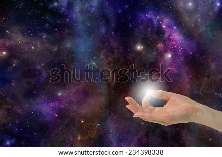 Gyan Mudra Hand Position creating the Spark of Life on a deep space background with planets, stars, suns, clouds and plenty of copy space