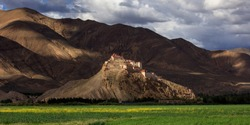 Gyantse Fortress, Gyantse Dzong - the Solemn Persistence of Ancient Tibet. Gyantse County, Shigatse Prefecture, Tibet Autonymous Region of China. Ancient architecture built at the top of a mountain.