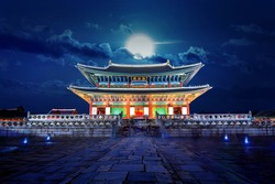 Gyeongbokgung palace and full moon at night in Seoul, South Korea.