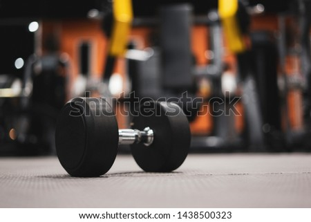Gym and dumbbell weight training equipment on sport ,Healthy life and gym exercise equipments and sports concept ,