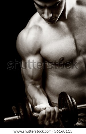 Gym and fitness concept - bodybuilder and dumbbell over black