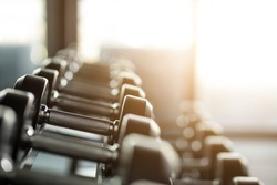 Gym background with Fitness equipment dumbbells weight for workout