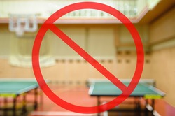 gym ban due to sanitary measures. Naturally blurred interior of modern gym with tables for ping-pong