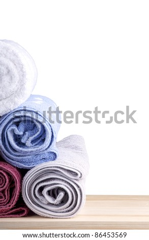 Gym concept - Freshly washed rolled towels isolated on white
