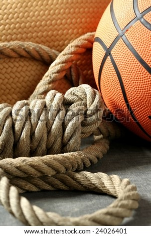 Gym corner, orange basketball ball and old rope
