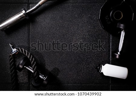 Gym equipment on dark background in cross Gym for fit people