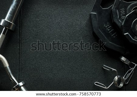 Gym equipment on floor.Frame of Sport background with empty space.