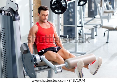 Gym fitness club indoor with young man training weights with legs