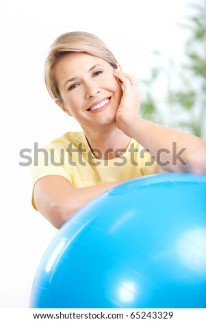 Gym & Fitness. Smiling elderly woman.