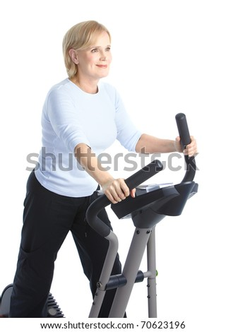 Gym & Fitness. Smiling elderly woman working out. Isolated over white background
