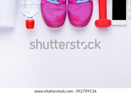 Gym fitness woman concept with copy space. Sport equipment.View from the top