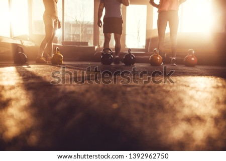 Gym floor with unrecognizable people in background. Copy space health club.
