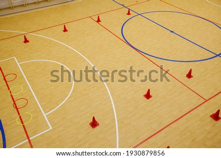 Gym for playing futsal, mini-football. Folded wooden parquet on the field of hall for mini-football. Futsal ball and bright line markings on the floor. Floor sports hall with bright lines of marking. Stock photo ©