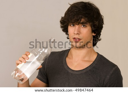Gym guy sweating and holding water bottle