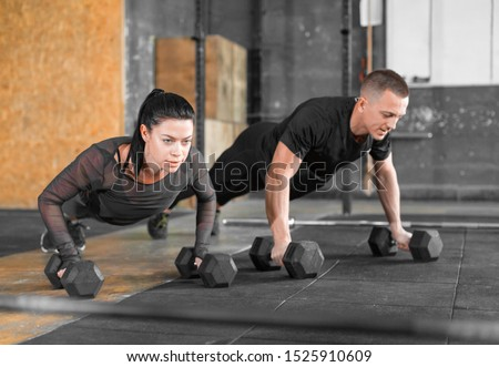 Gym man and woman push-up. Strength pushup, Workout. Active and sporty lifestyle.