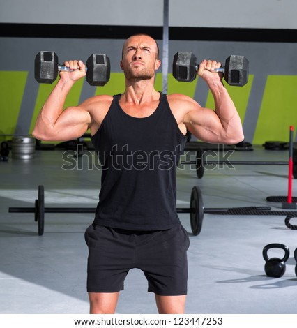 Gym man with dumbbells weights lifting exercise fitness workout
