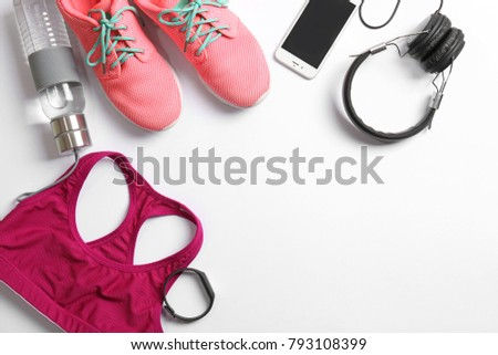 Shutterstock Gym stuff, mobile phone and blank space for exercise plan on white background. Flat lay composition