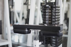 Gym weight equipment machine. Weight on lifting machine. Weight plate for training in fitness room