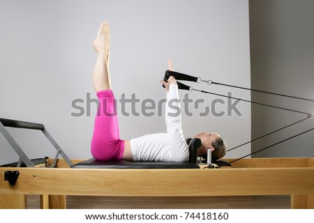 gym woman pilates stretching sport in reformer bed instructor girl - stock photo