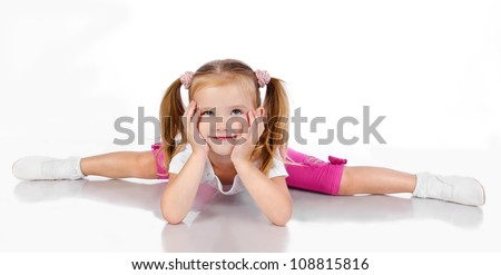 Gymnast cute little girl isolated on a white