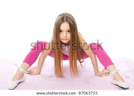 gymnast little girl isolated on white