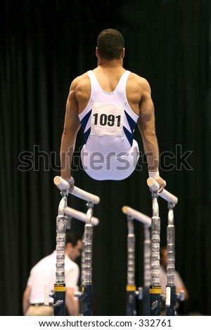 Gymnast on parallel bars - stock photo