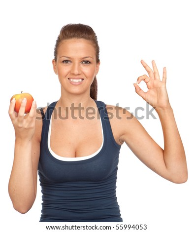 Gymnastics girl with an apple saying OK on white background