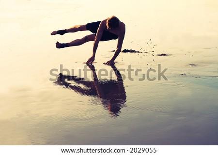 Gymnastics on a beach