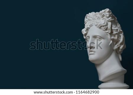 Gypsum statue of Apollo's head space for text. Man. Statue. Blue statue of Apollo's head. Apollo Belvedere. Сreative. Sculptur. Renaissance. Голова Аполлона Бельведерского из гипса. ancient.