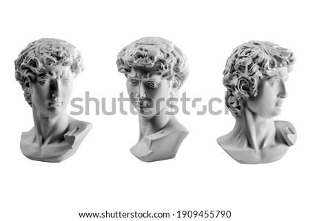 Gypsum statue of David's head. Michelangelo's David statue plaster copy isolated on white background. Ancient greek sculpture, statue of hero.