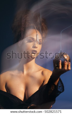 Gypsy Fortune Teller Practicing Magic Looking Into Crystal