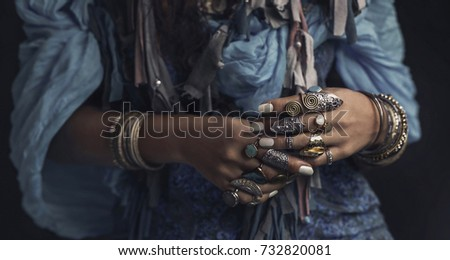 gypsy style young woman wearing tribal jewellery close up