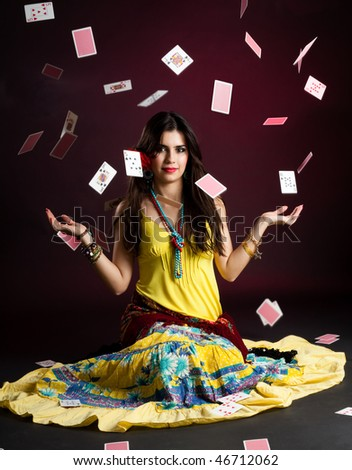 Gypsy woman with and cards magic