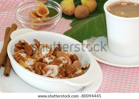 H'orderves created by stuffing fresh figs with salty pecans and sour cream sprinkled with cinnamon.  Served with hot mocha and chocolate cinnamon cookies.