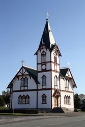 Húsavík lutheran church in Iceland with a beautiful blue sky.